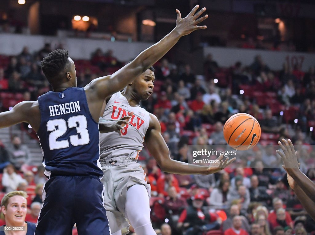 Amauri Hardy #3 of the UNLV Rebels passes the ball against Daron Henson #23 of the Utah State Aggies during their game at the Thomas & Mack Center on January 6, 2018 in Las Vegas, Nevada.