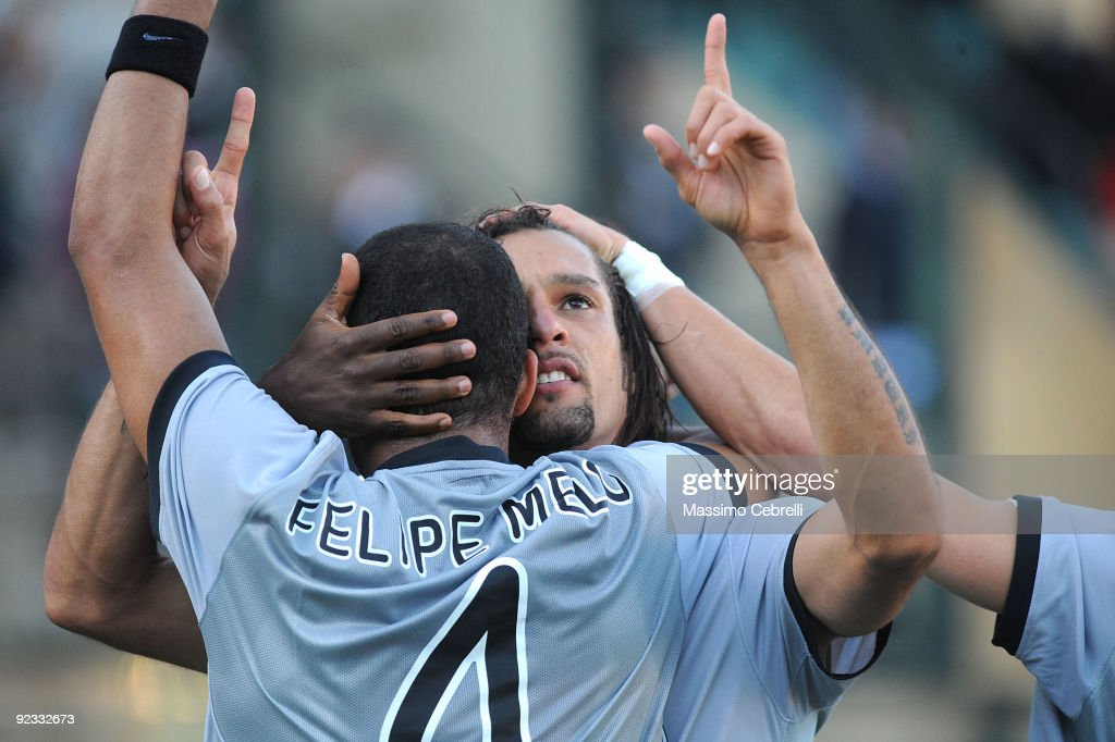 Amauri of Juventus FC celebrates his first goal with teammate <a gi-track='captionPersonalityLinkClicked' href=/galleries/search?phrase=Felipe+Melo&family=editorial&specificpeople=646942 ng-click='$event.stopPropagation()'>Felipe Melo</a>during the Serie A match between AC Siena and Juventus FC at Artemio Franchi - Mps Arena Stadium on October 25, 2009 in Siena, Italy.