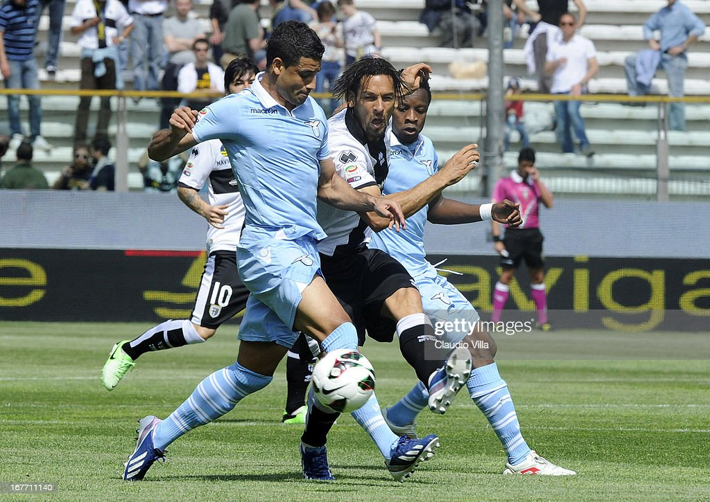 Amauri of Parma FC and Ederson of S.S. Lazio (L) compete for the ball during the Serie A match between Parma FC and S.S. Lazio at Stadio Ennio Tardini on April 28, 2013 in Parma, Italy.