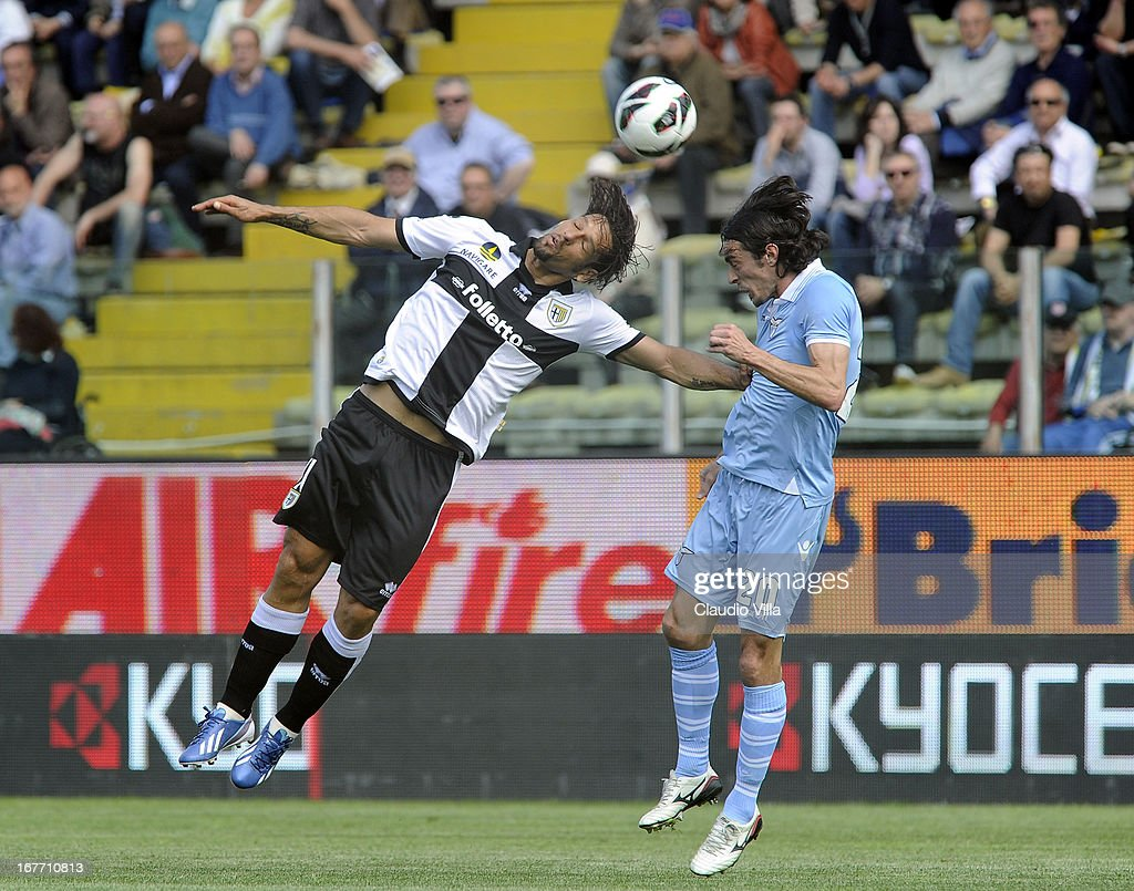 Amauri of Parma FC and Giuseppe Biava (R) of S.S. Lazio compete for the ball during the Serie A match between Parma FC and S.S. Lazio at Stadio Ennio Tardini on April 28, 2013 in Parma, Italy.