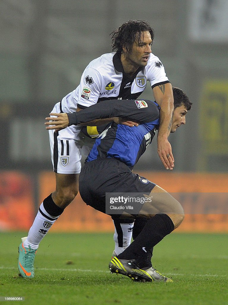 Amauri of Parma FC #11 and Javier Zanetti of FC Inter Milan during the Serie A match between Parma FC and FC Internazionale Milano at Stadio Ennio Tardini on November 26, 2012 in Parma, Italy.