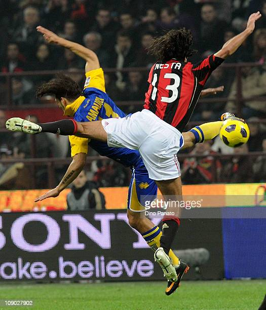 Amauri of Parma jumps in the air with Alessandro Nesta of Milan during the Serie A match between AC Milan and Parma FC at Stadio Giuseppe Meazza on...