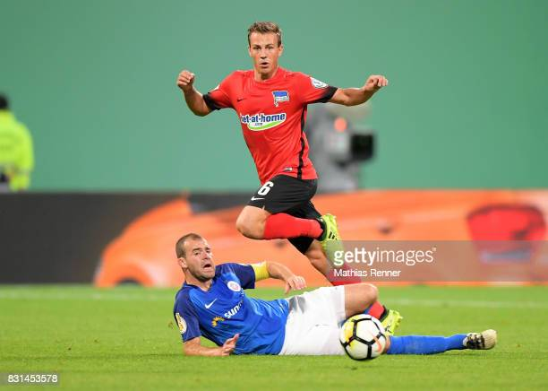 Amaury Bischoff of FC Hansa Rostock and Vladimir Darida of Hertha BSC during the game between FC Hansa Rostock and Hertha BSC on August 14 2017 in...