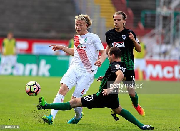 Amaury Bischoff of Muenster challenges Jesper Verlaat of Bremen II during the match between Preussen Muenster and Werder Bremen II at Preussenstadion...