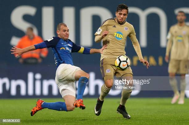 Amaury Bischoff of Rostock battles for the ball with Ahmet Metin Arslan of Osnabrueck during the third league match between FC Hansa Rostock and VfL...