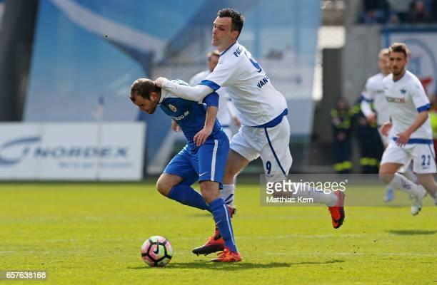 Amaury Bischoff of Rostock battles for the ball with Koen van der Biezen of Paderborn during the third league match between FC Hansa Rostock and SC...