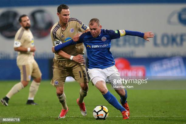 Amaury Bischoff of Rostock battles for the ball with Tim Danneberg of Osnabrueck during the third league match between FC Hansa Rostock and VfL...