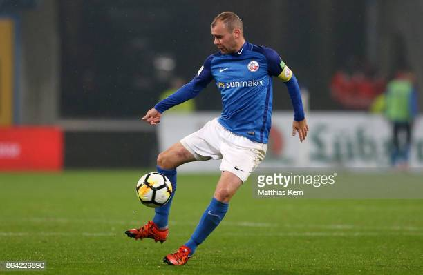 Amaury Bischoff of Rostock runs with the ball during the third league match between FC Hansa Rostock and VfL Osnabrueck at Ostseestadion on October...