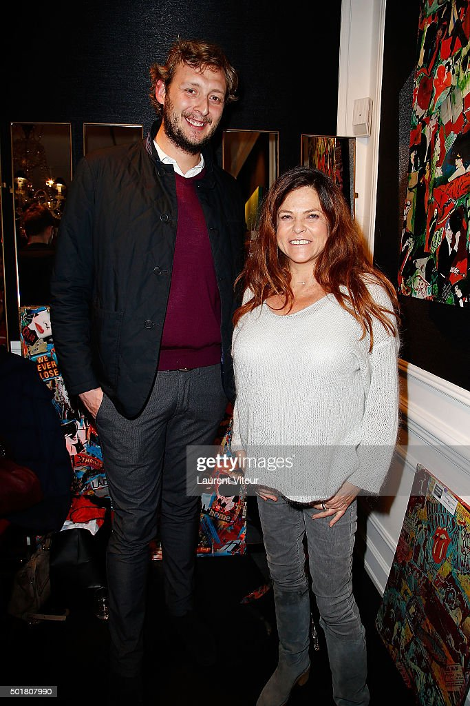 Amaury Levaux and Charlotte Valandrey attend 'Accords Croises' Anne Mondy's exhibition at Rue Bonaparte on December 17, 2015 in Paris, France.
