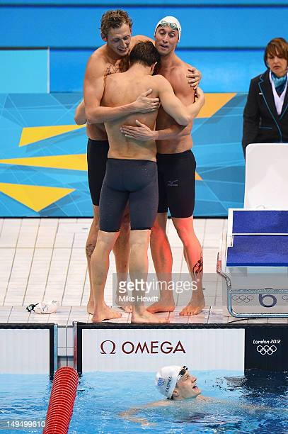 Amaury Leveaux Clement Lefert Yannick Agnel and Fabien Gilot of France celebrate after winning the gold in the Men's 4x100m Freestyle relay on Day 2...