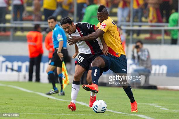 Amaury Ponce of Atlas fights for the ball with Duvier Riascos of Morelia during a match between Morelia and Atlas as part of 2nd round Apertura 2014...