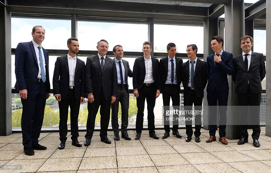 Amaury Sport organisation (ASO) deputy head for cyclism Pierre-Yves Thouault, French Romain Bardet and Alexis Wuillermoz of AG2R La Mondiale, Warren Barguil of Team Giant-Alpecin, Arnaud Demare of La Fran��aise des Jeux, Economy Minister Emmanuel Macron, Secretary of State for Sports Thierry Braillard, Nacer Bouhanni of Cofidis team and Tour de France race director, Christian Prudhomme pose prior to a meeting at the Economy Ministry in Paris on May 3, 2016. / AFP / ERIC