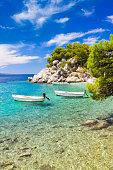 Amazing beach with boats in Brela, Makarska Riviera, Dalmatia, Croatia