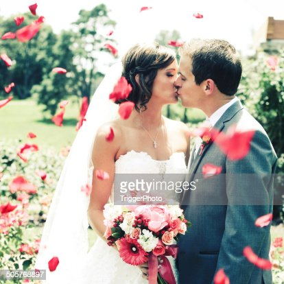 Amazing Bride and Groom Kissing Wedding Dress Flowers