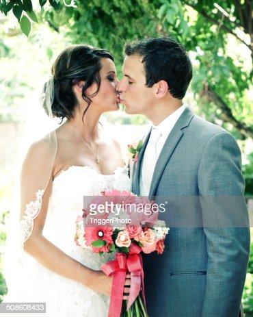 Amazing Bride and Groom Kissing Wedding Dress Flowers : Stock Photo