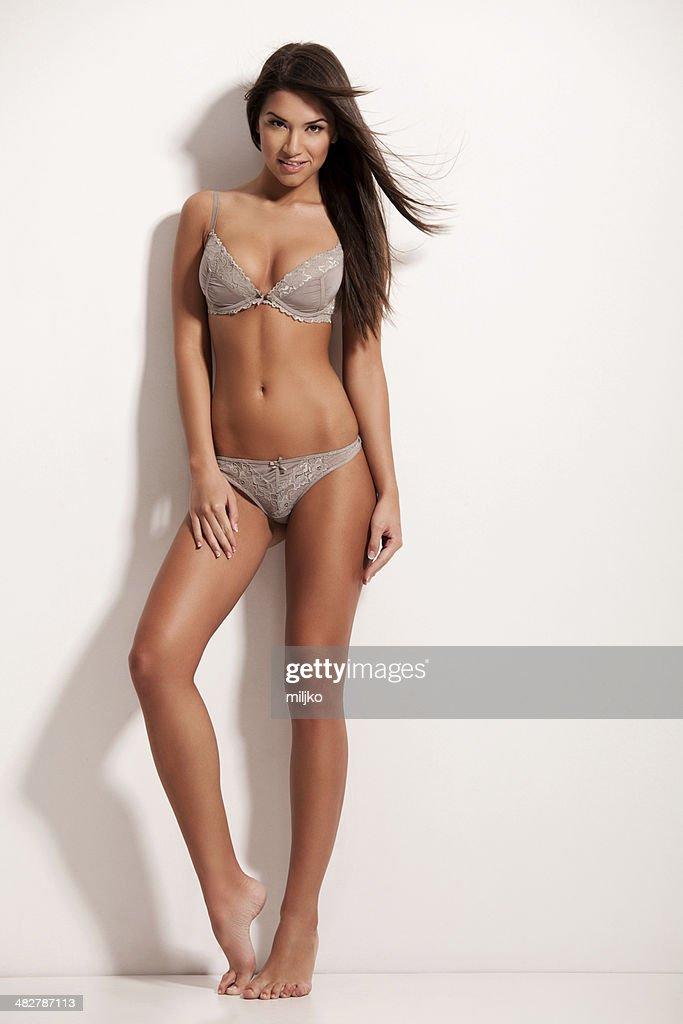 Amazing brunette posing in lingerie