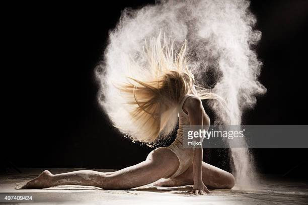 Amazing dancer dancing in powder snow