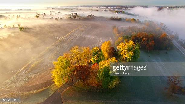 Amazing foggy rural Wisconsin landscape, aerial view at dawn