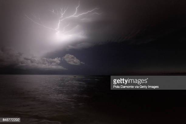 Amazing lightning storm sunset and calmed ocean, at Naples beach, Florida, USA