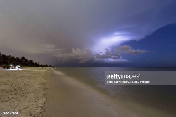 Amazing lightning storm sunset and calmed ocean, at Naples beach, Florida, USA