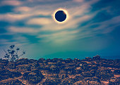Amazing scientific natural phenomenon. Total solar eclipse glowing on sky above wilderness area in forest. Abstract fantastic background of beautiful nature and serenity landscape. Cross process.
