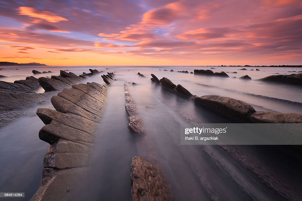 An isolated expanse of rock formations and cobble fragments, Sakoneta is a clothing-optional beach in northern Spain's autonomous community of País Vasco. The swimming conditions are rough, with wind and strong waves, but the sunsets can be glorious.