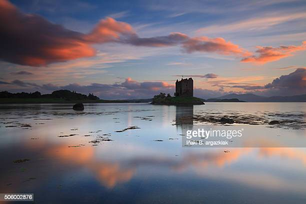 Amazing sunset with reflections at Castle Stalker