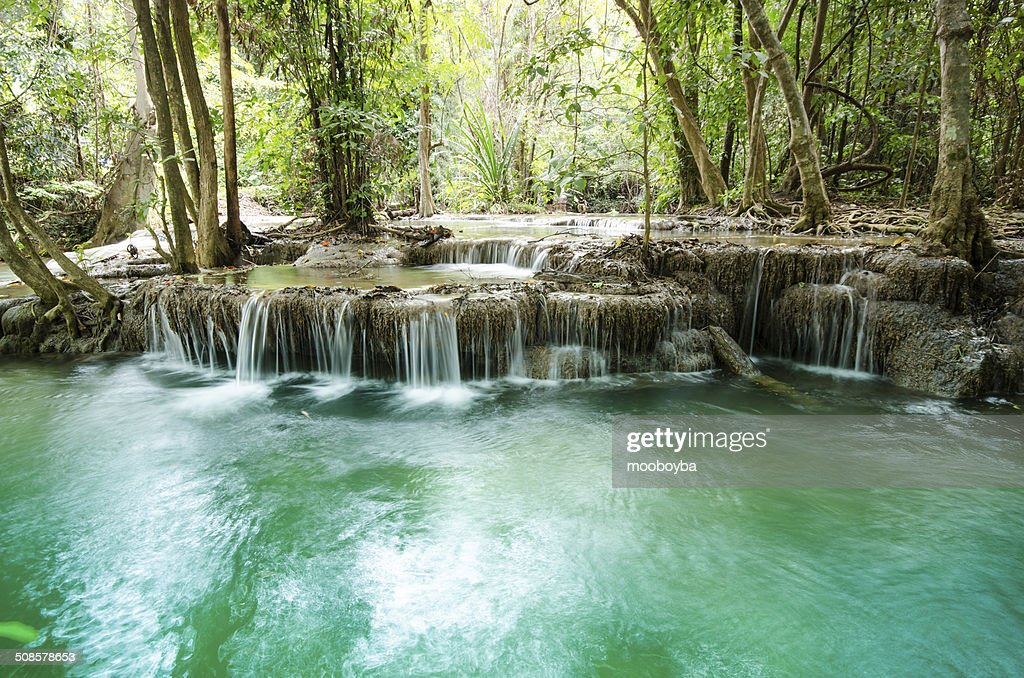 Amazing Thailand waterfall in autumn forest : Bildbanksbilder