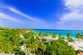 stunning gorgeous beautiful, amazing view of Holguing province tropical inviting beach and tranquil azure turquoise ocean on blue sky background