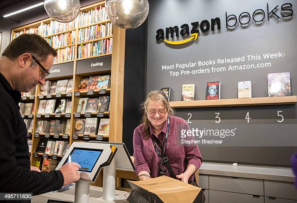 Amazon associate Katherine Sotol left bags up a purchase for customer Don Taufen of Seattle Washington at the newlyopened Amazon Books store on...
