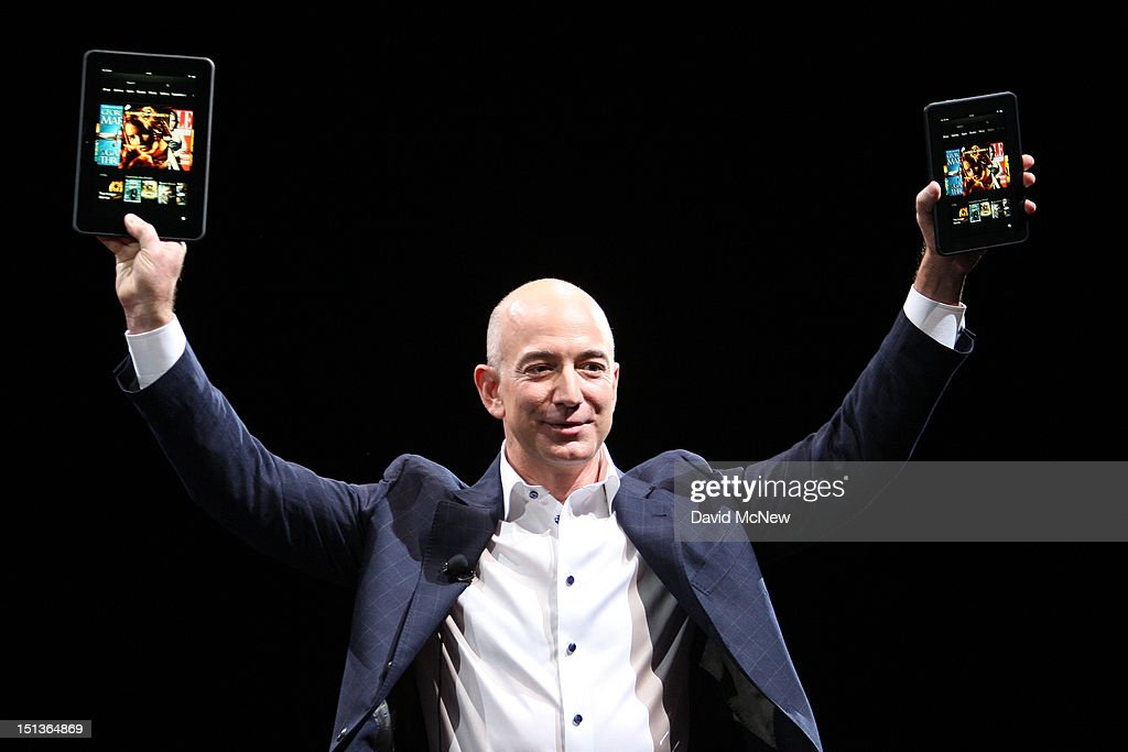 Amazon CEO <a gi-track='captionPersonalityLinkClicked' href=/galleries/search?phrase=Jeff+Bezos&family=editorial&specificpeople=217573 ng-click='$event.stopPropagation()'>Jeff Bezos</a> holds up the new Kindle Fire HD reading device in two sizes during a press conference on September 6, 2012 in Santa Monica, California. Amazon unveiled the Kindle Fire HD in 7 and 8.9-inch sizes, with prices starting at $199.