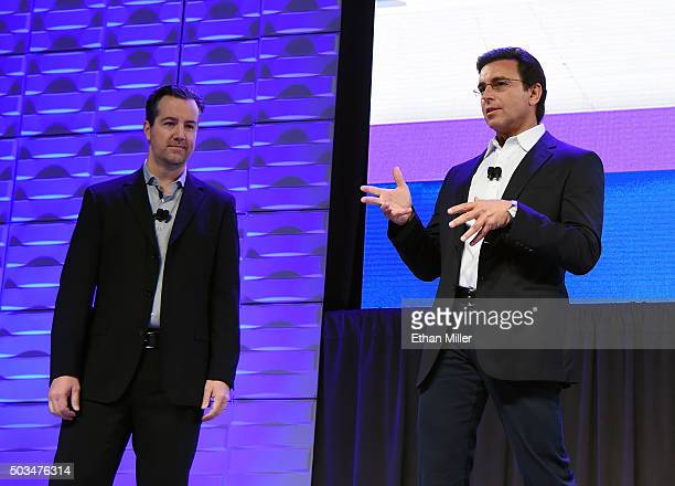 Amazon Echo and Alexa Voice Services Vice President Greg Hart and President and CEO of Ford Motor Co Mark Fields speak during a Ford press event for...