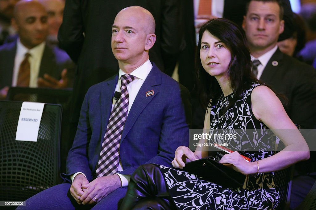 Amazon founder and Washington Post owner <a gi-track='captionPersonalityLinkClicked' href=/galleries/search?phrase=Jeff+Bezos&family=editorial&specificpeople=217573 ng-click='$event.stopPropagation()'>Jeff Bezos</a> and his wife MacKenzie Bezos participate in the opening ceremony of the newspaper's new location January 28, 2016 in Washington, DC. Bezos purchased the newspaper and media company in October of 2013 from the storied Graham family.