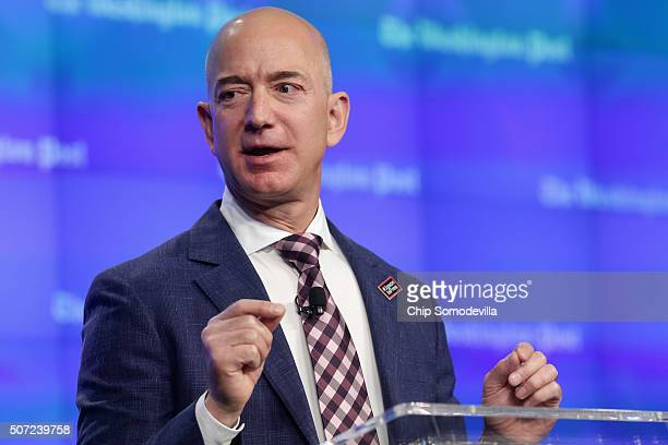 Amazon founder and Washington Post owner Jeff Bezos delivers remarks during the opening ceremony of the media company's new location January 28 2016...