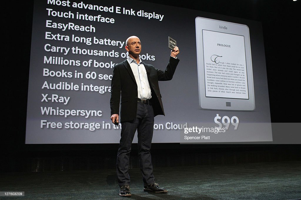 Amazon founder <a gi-track='captionPersonalityLinkClicked' href=/galleries/search?phrase=Jeff+Bezos&family=editorial&specificpeople=217573 ng-click='$event.stopPropagation()'>Jeff Bezos</a> holds a new $99 Kindle on September 28, 2011 in New York City. The Fire, which will be priced at $199, is an expanded version of the company's Kindle e-reader that has 8GB of storage and WiFi. The Fire gives users access to streaming video, as well as e-books, apps and music, and has a Web browser. In addition to the Fire, Bezos introduced four new Kindles including a Kindle touch model.