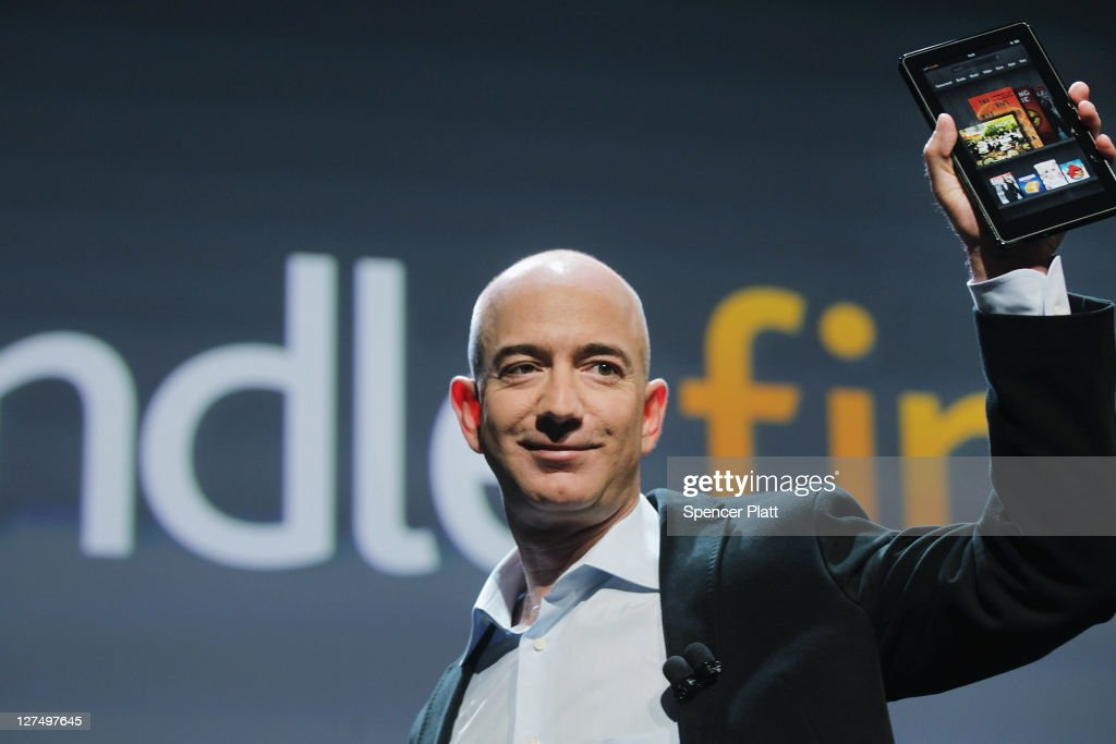 Amazon founder <a gi-track='captionPersonalityLinkClicked' href=/galleries/search?phrase=Jeff+Bezos&family=editorial&specificpeople=217573 ng-click='$event.stopPropagation()'>Jeff Bezos</a> holds the new Amazon tablet called the Kindle Fire on September 28, 2011 in New York City. The Fire, which will be priced at $199, is an expanded version of the company's Kindle e-reader that has 8GB of storage and WiFi. The Fire gives users access to streaming video, as well as e-books, apps and music, and has a Web browser. In addition to the Fire, Bezos introduced four new Kindles including a Kindle touch model.