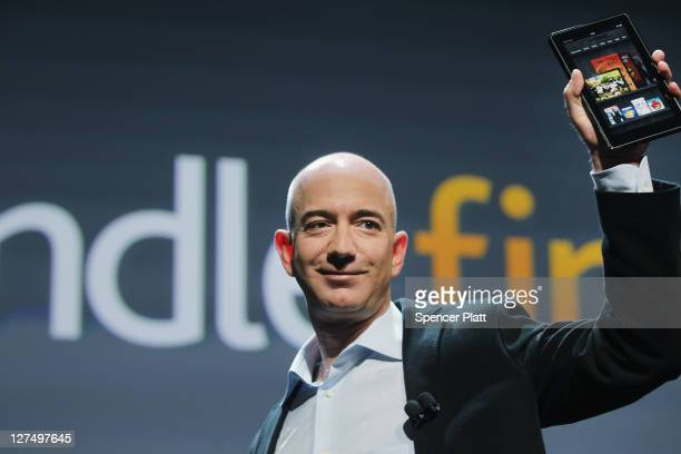 Amazon founder Jeff Bezos holds the new Amazon tablet called the Kindle Fire on September 28 2011 in New York City The Fire which will be priced at...