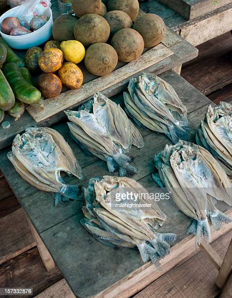 Amazon river market stall with fish and fruit at Iquitos