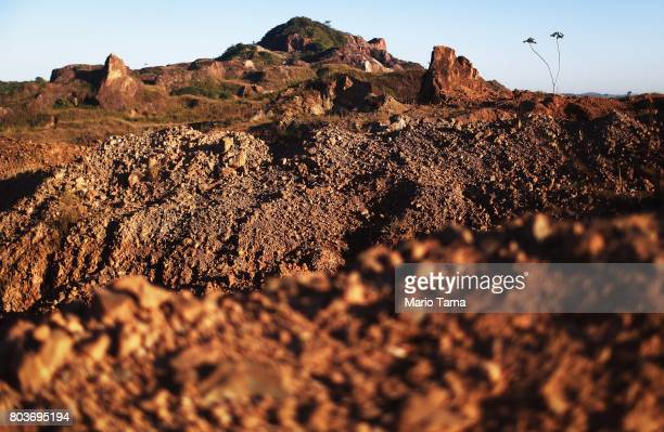 Amazon soil sits in the foreground at the Bom Futuro open air tin mine one of the largest tin mines in the world in a deforested section of the...