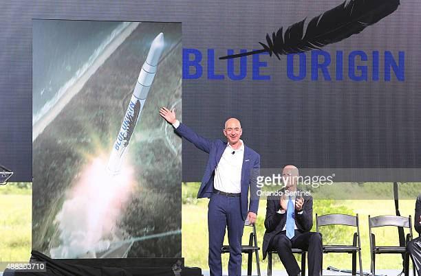 Amazoncom CEO and Blue Origin founder Jeff Bezos left debuts a launch vehicle on Tuesday Sept 15 as Florida Gov Rick Scott applauds during a press...