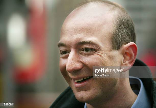 Amazoncom CEO Jeff Bezos smiles before opening the NASDAQ Stock Market November 18 2002 in New York City The electricpowered Segway transporter went...