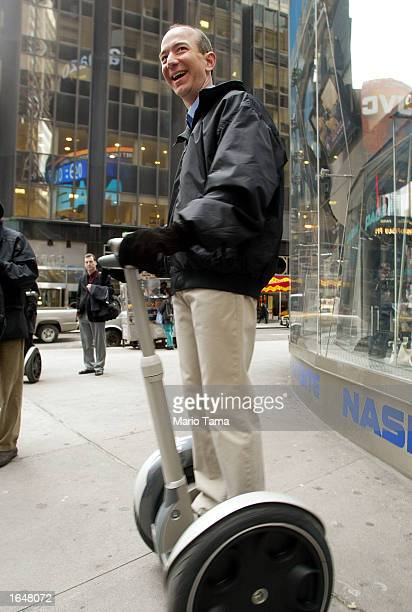 Amazoncom CEO Jeff Bezos stands on a Segway before opening the NASDAQ Stock Market November 18 2002 in New York City The electricpowered transporter...