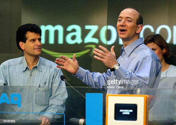 Amazoncom CEO Jeff Bezos stands with Segway inventor Dean Kamen while opening the NASDAQ Stock Market November 18 2002 in New York City The...