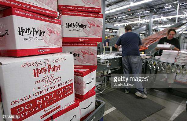 Amazoncom employees pack copies of the new book 'Harry Potter and the Deathly Hallows' for shipment July 16 2007 at an Amazon fulfillment center in...