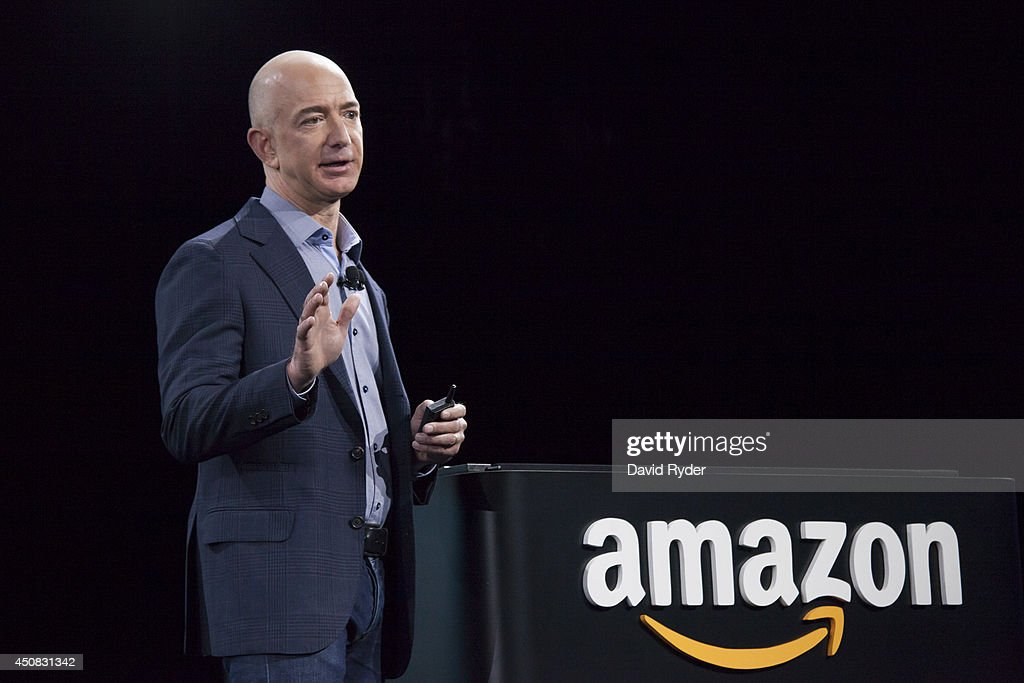 Amazon.com founder and CEO <a gi-track='captionPersonalityLinkClicked' href=/galleries/search?phrase=Jeff+Bezos&family=editorial&specificpeople=217573 ng-click='$event.stopPropagation()'>Jeff Bezos</a> presents the company's first smartphone, the Fire Phone, on June 18, 2014 in Seattle, Washington. The much-anticipated device is available for pre-order today and is available exclusively with AT&T service.