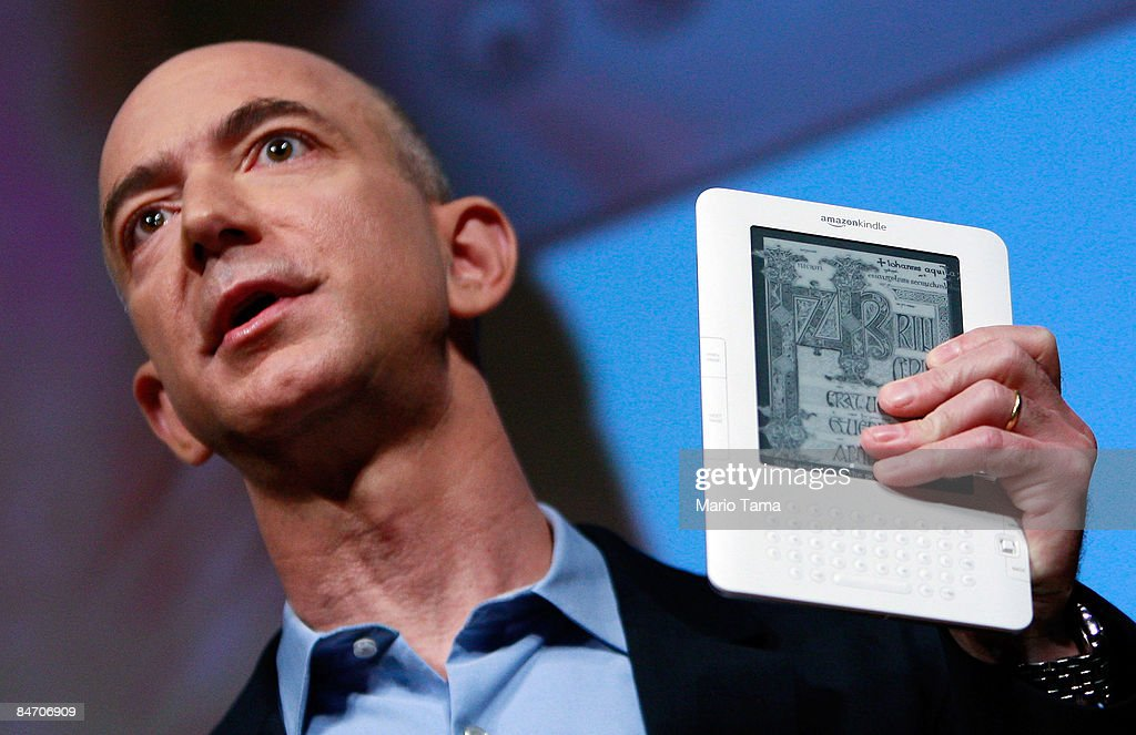 Amazon.com founder and CEO Jeffrey P. Bezos holds the new Amazon Kindle 2.0 at an unveiling event at the Morgan Library & Museum February 9, 2009 in New York City. The updated electronic reading device is slimmer with new syncing technology and longer battery life and will begin shipping February 24th.
