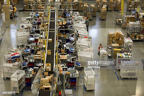 Amazoncom Inc employees process customer orders at the company's fulfillment center ahead of Cyber Monday in Tracy California US on Sunday Nov 30...