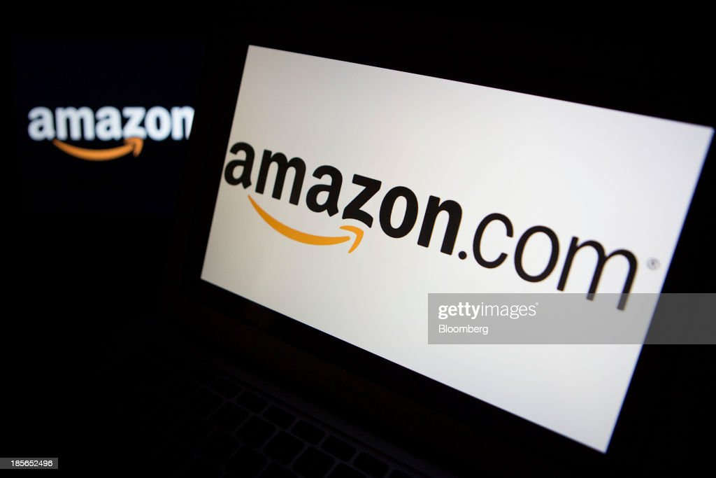 Amazon.com Inc. logos are displayed on laptop computers in Washington, D.C., U.S., on Wednesday, Oct. 23, 2013. Amazon.com Inc. is scheduled to release third-quarter earnings on Oct. 24. Photographer: Andrew Harrer/Bloomberg via Getty Images