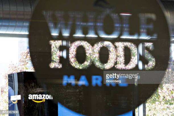 Amazoncom Inc signage is displayed at a PopUp store inside the Lakeview Whole Foods Market Inc store in Chicago Illinois US on Monday Nov 20 2017...