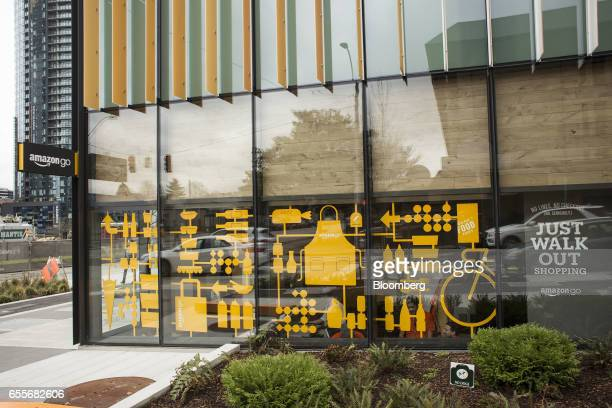 Amazoncom Inc signage is displayed outside of the company's Amazon Go grocery store in Seattle Washington US on Wednesday March 8 2017 Amazon's goal...